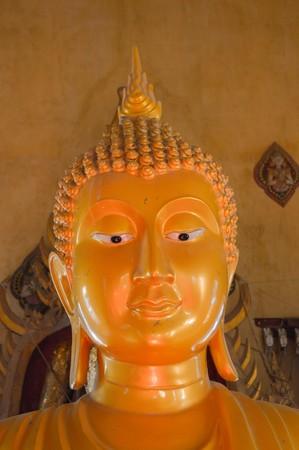 praye: gold buddha statue in public temple Thailand Stock Photo