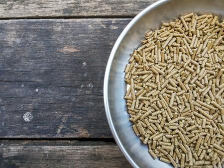 Animal food on wood floor Stockfoto