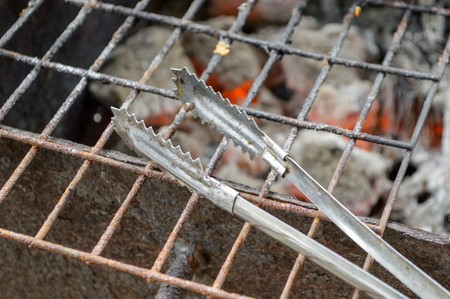 grate: kitchen tongs on grill grate