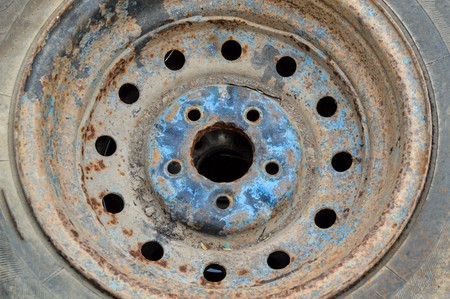 corroded: Close up of a rusty corroded car wheel Stock Photo
