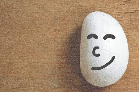 white happy stone on wood floor 版權商用圖片