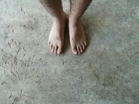 man: Foot man on cement floor Stock Photo