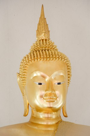 steel: close up gold buddha statue in public temple thailand
