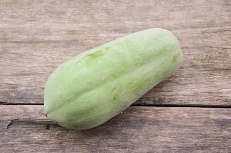 green papaya: green papaya on wood plank