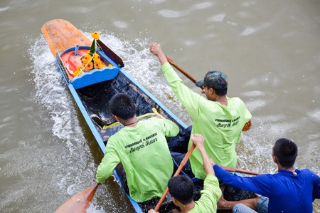 boat crew: CHACHOENGSAO,THAILAND - November 8 : Unidentified crew in traditional Thai long boats compete during Country cup. Traditional Long Boat Race Championship on November 8, 2015 in Chachoengsao, Thailand.