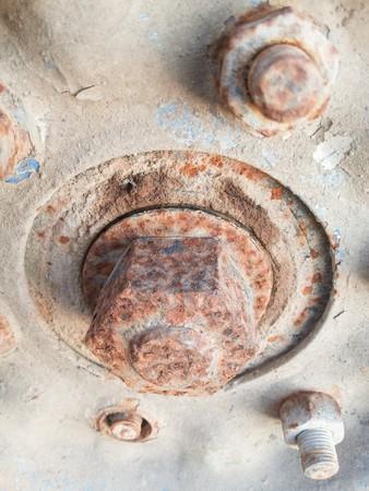 close up rusty bolts on wheel hub