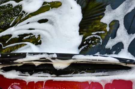 Car wash with flowing water and foam