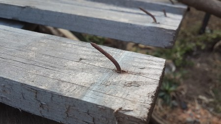 rusty nail: Rusty nail in obsolete wood plank