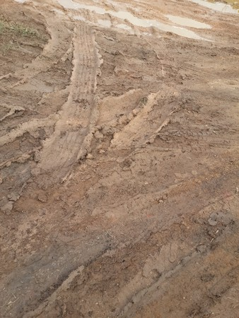 mud print: Dirt road in country Thailand