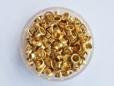 punch press: brass eyelets