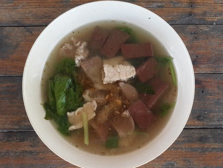 entrails: Boiled pigs blood with entrails in soup - Thailand healthy food Stock Photo