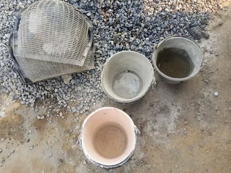 バケツと建設側の石 写真素材
