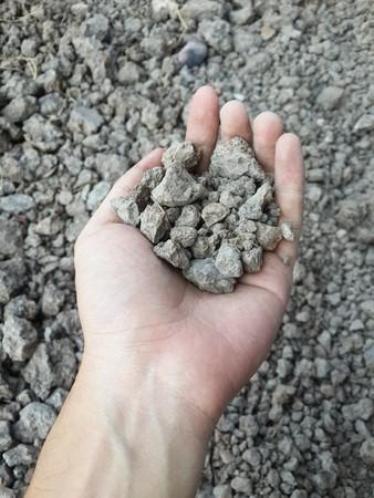 soil on man hand