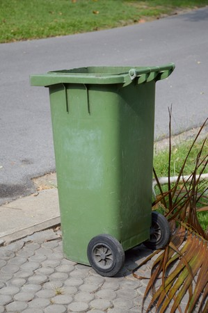 green plastic bin in nature garden Stock Photo
