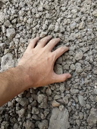 earth handful: hand on dry soil