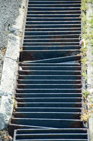 to grate: Close up of grunge grate on the floor Stock Photo