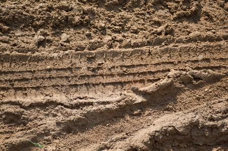 mud print: wheel tracks on dry soil