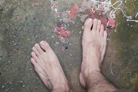 dirty feet: foot on old cement floor