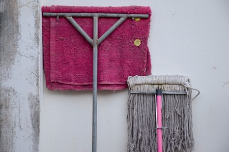 old mops on cement wall