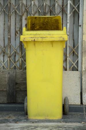close up yellow plastic bin