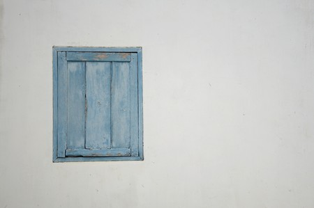 crack house: wood window on cement wall Stock Photo