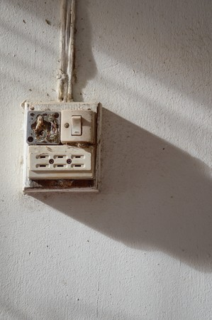 conductor electricity: close up old plug old cement wall Stock Photo