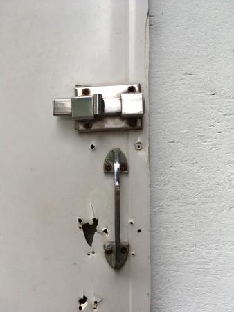 Close up old latch door