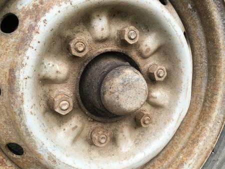 alloy wheel: old rusty metal alloy wheel car Stock Photo