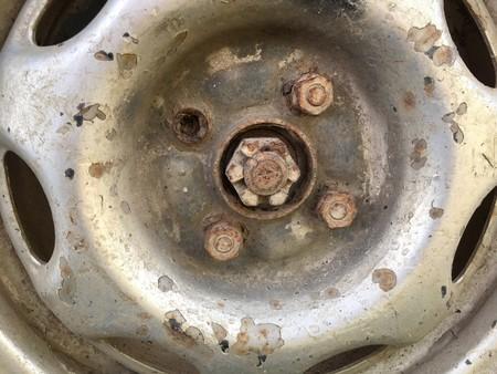 rusty car: old rusty metal alloy wheel car Stock Photo