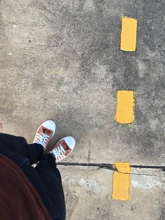 close up man feet on cement floor near railway at country Bangkok Thailand