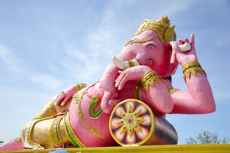 pink ganesh statue on blue sky Stock Photo