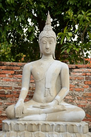 old buddha statue in public temple at Ayutthaya , Thailand