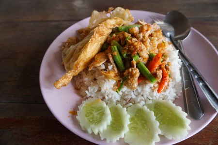long bean: fried minced pork and yard long bean and chili paste and egg on hot rice Stock Photo