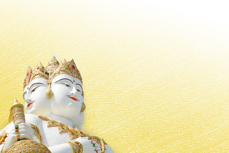 big white statue of brahma on yellow background Stock Photo