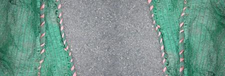 green sun shading net on asphalt road texture Banco de Imagens