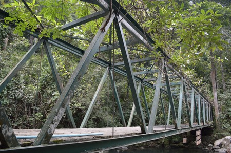 old metal bridge in country forest Thailand