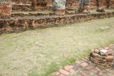 grass floor way in public temple at Ayutthaya , Thailand Фото со стока