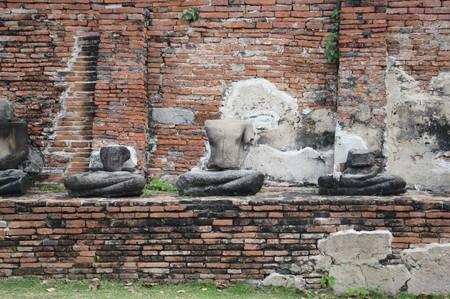 close up old broken Buddha statue at Chaiwatthanaram Temple, Ayutthaya, Thailand