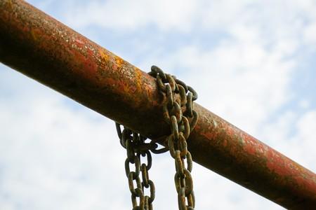 old chain on iron pole