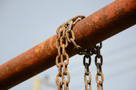 old chain on iron pole