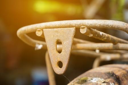 Close up rusty iron bike Stock Photo
