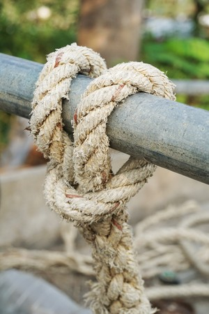 close up green rope on iron pole Stock Photo