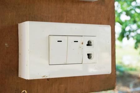 close up Switch and hole plug on wood pole Stock Photo