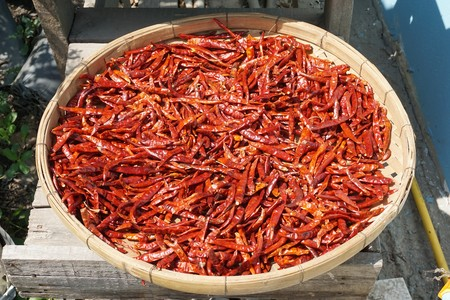 dry red chili on bamboo basket