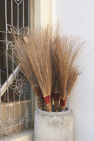 Close up coconut broom in store Stock Photo