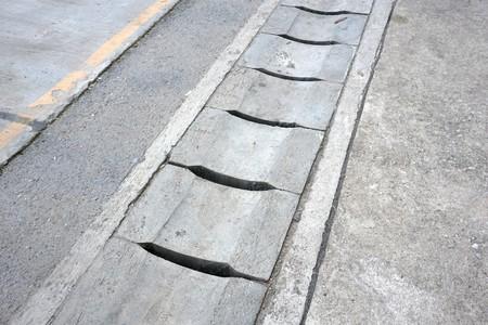 Cement drain on the floor Stock Photo