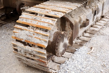 close up dry mud on stuck backhoe wheels