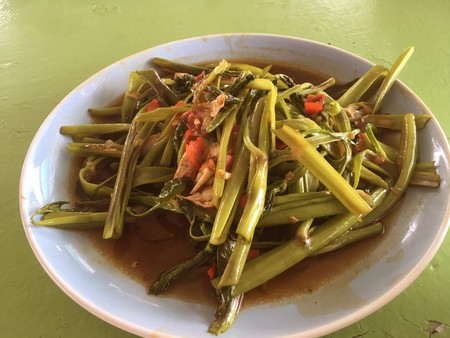 stir fried water spinachon on plate