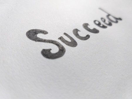 text succeed on paper - Image Stock Photo