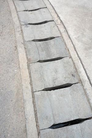 Cement drain on the floor Imagens